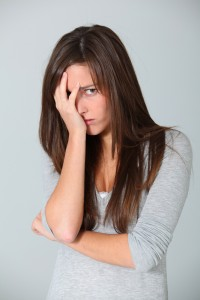worried-woman-with-hand-on-her-face-200x300